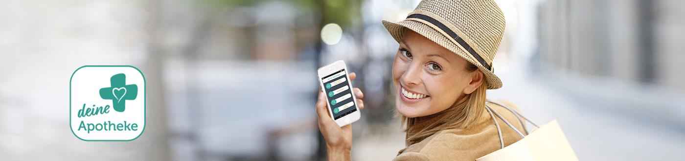 Junge Frau nutzt die deine Apotheke App